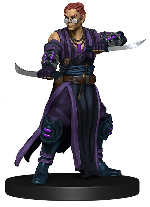 promo mini figure of a half elf with his hair pulled back, wearing dark purple and black robes with two knives held out horizontally