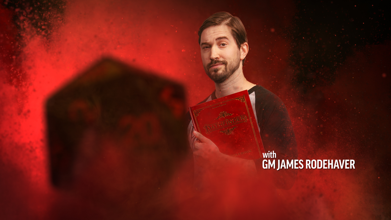 GM James Rodehaver, a man standing in a red smokey background holding a core rulebook, with a D20 dice in the foreground