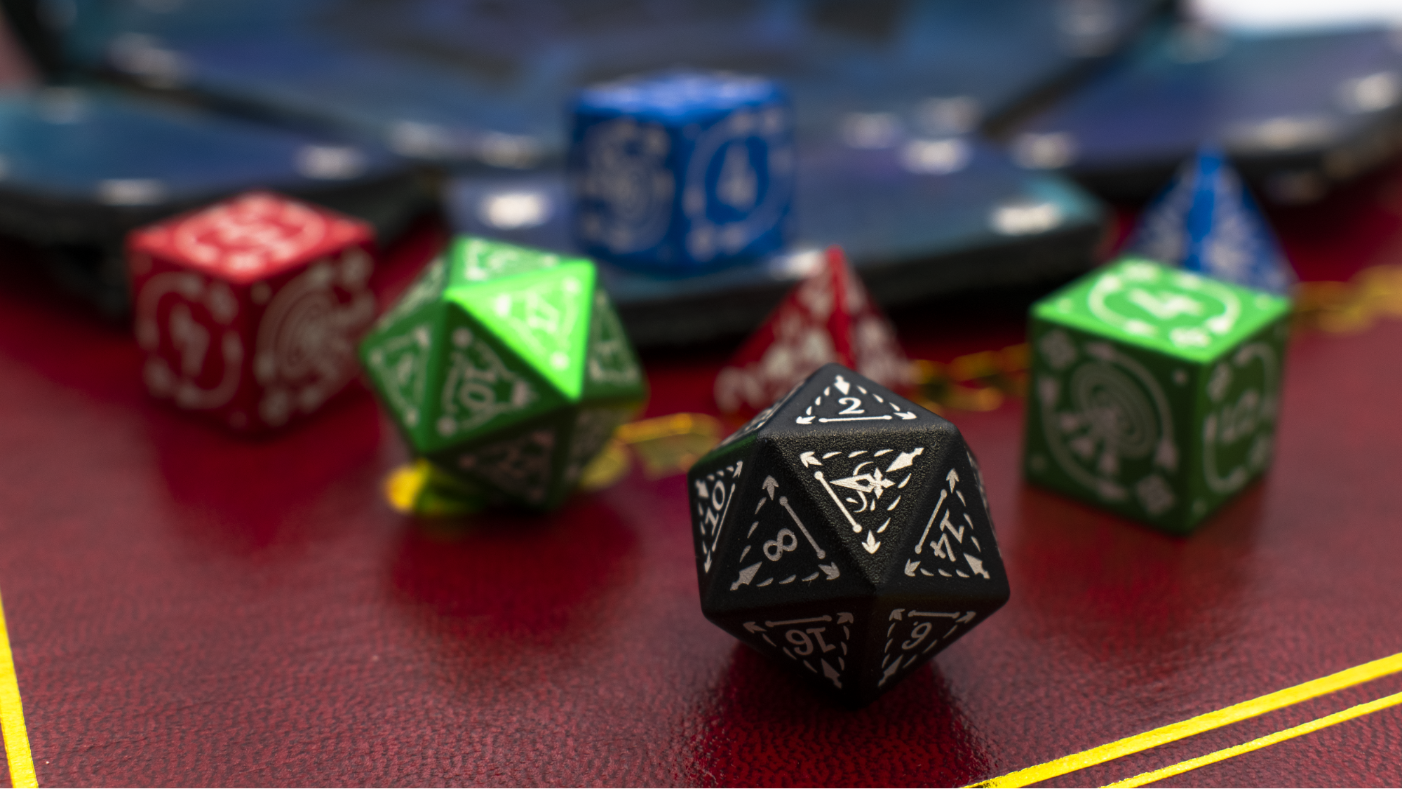 image of a set of rogue dice in colors black, green, red, and blue