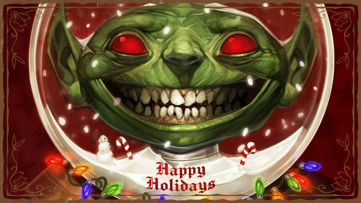 Paizo Happy Holidays card, featuring a red eyed smiling goblin with its space helmet turned into a snow globe and lights around its neck