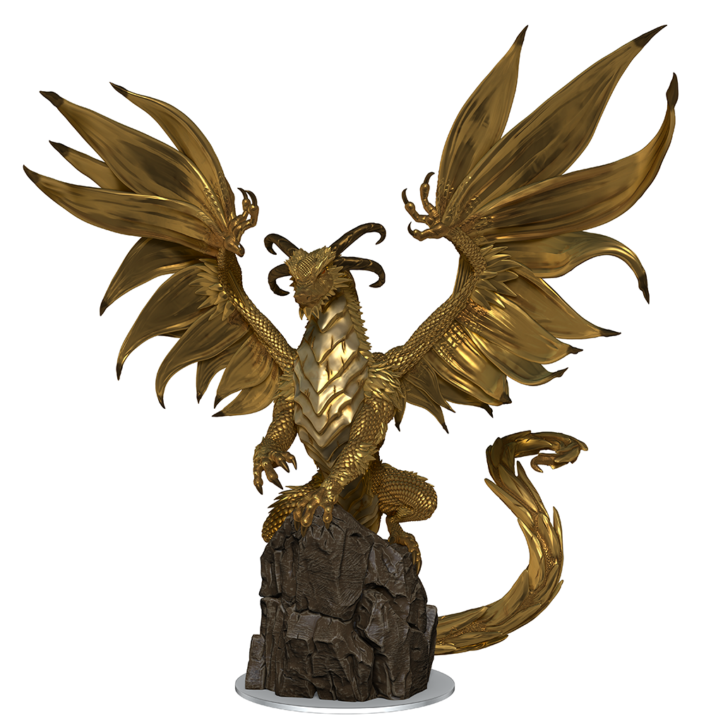 a mini figure of a golden dragon rearing back on a large stone with its wings spread