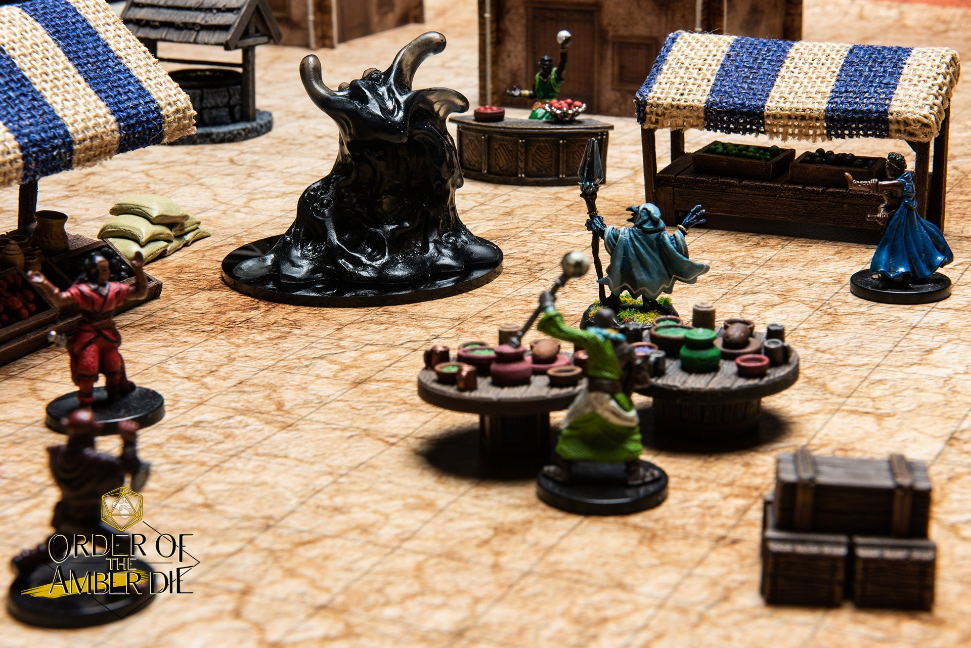 A model of a town marketplace, The players' figures suround and defend the market from a large Ooze