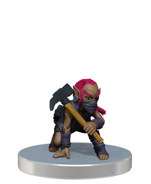 promo mini figure of a pink haired gnome scout dressed in dark wraps and leathers, with a mask over their lower face, crouched with a mattock