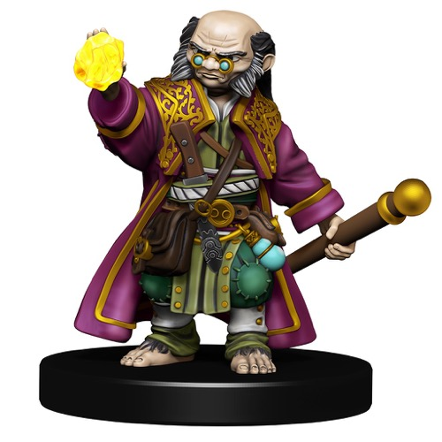 A bald-headed Halfling Wizard with bushy sideburns scowls over his eyeglasses as he raises a glowing yellow gem in his right hand.