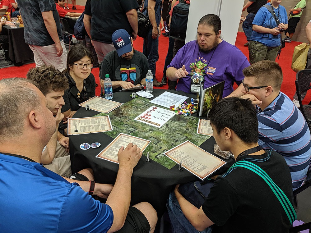 Many folks playing demos at near our GenCon booth.