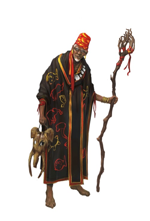 An elderly man in dark robes decorated with animal imagery holds a gnarled staff in one hand and a wooden elephant mask in the other.